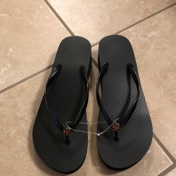 2d1760cae455d2 Tory Burch black wedge flip flops size 10